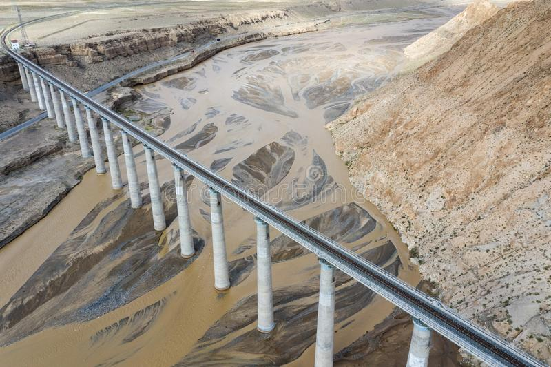 Aerial view of railroad bridge on kunlun river stock photos