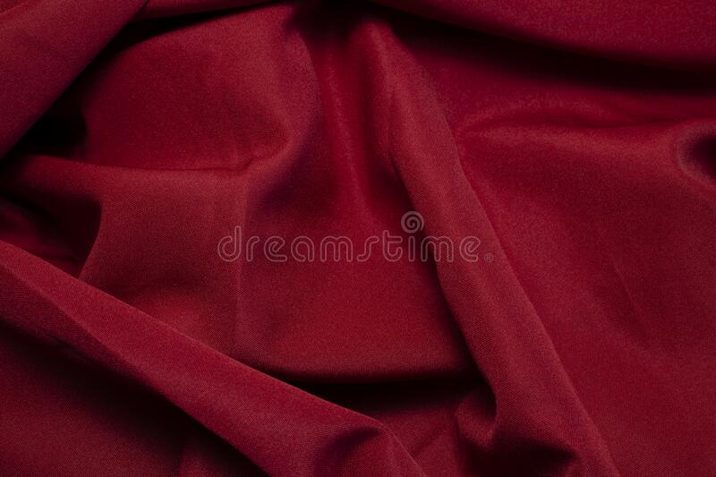 I felt scarlet. Aerial view of red fabric, with texture and wrinkles, chilliness, with soft sensation, background, texture and raw material royalty free stock image