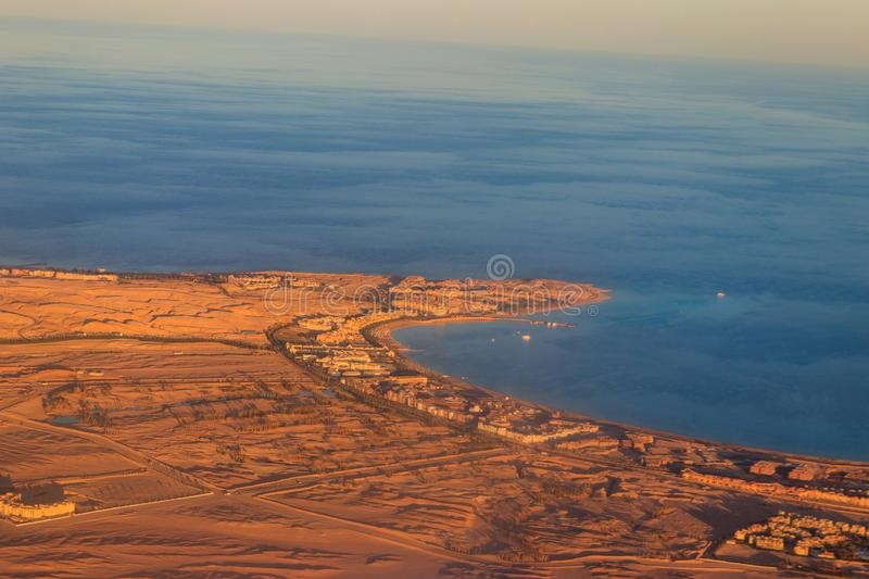 Aerial view on Red sea, Arabian desert and touristic resort near Hurghada, Egypt. View from airplane. Aerial view on the Red sea, Arabian desert and touristic royalty free stock image