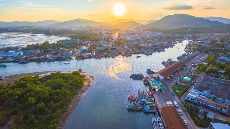 Aerial view reflection of sunset at three junction canal. Aerial scenery sunset at Siray fishing port. Phuket Fishing Port is the largest fishing port. Located royalty free stock photos