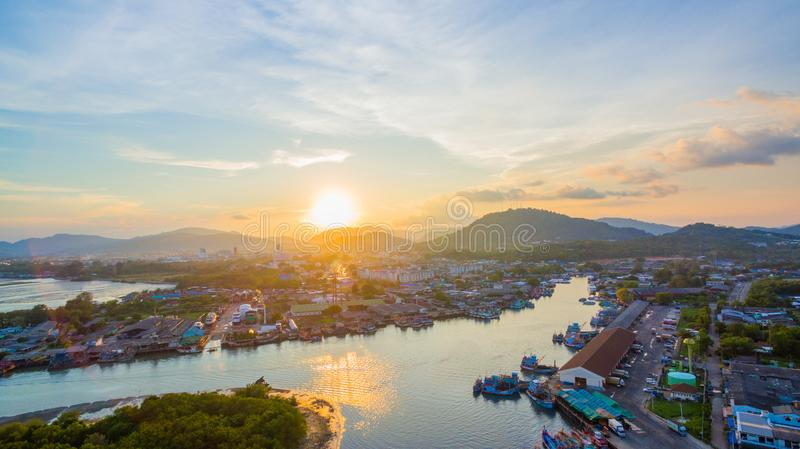 Aerial view reflection of sunset at three junction canal. Aerial scenery sunset at Siray fishing port. Phuket Fishing Port is the largest fishing port. Located stock photo