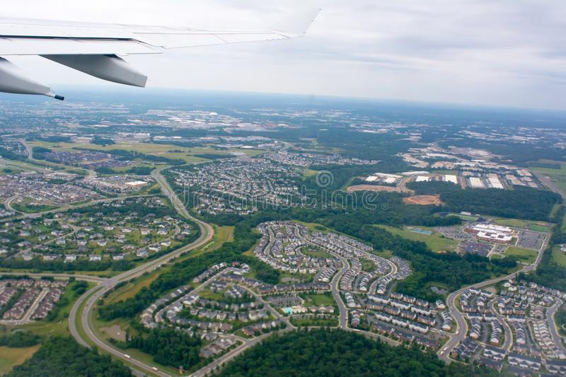 Aerial View of Residence Houses taken from Flying Airplane on Blur Background. Aerial View of Residence Houses taken from Flying Airplane, above, apartment royalty free stock photos