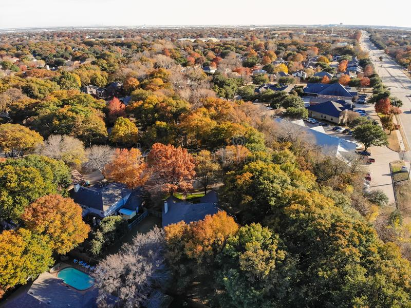 Top view residential houses with garden, garage and colorful autumn leaves near Dallas. Aerial view residential neighborhood with colorful fall foliage nears in royalty free stock images