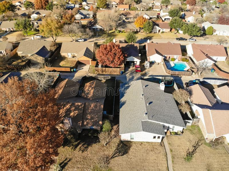 Aerial view rich houses with swimming pool in autumn near Dallas, Texas. Top view upscale neighborhood with luxury house and swimming pools surround by colorful royalty free stock photo