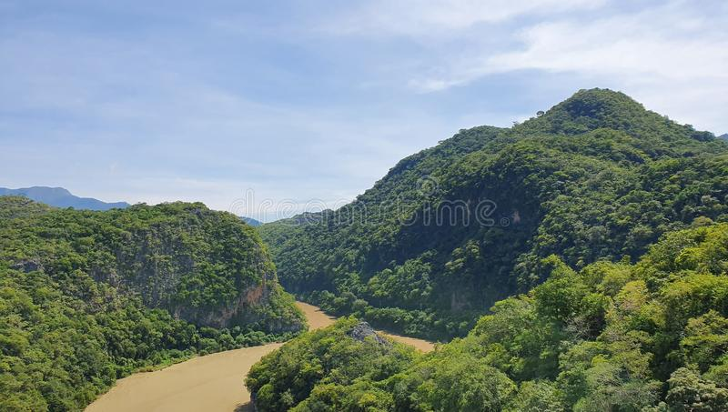 aerial view of a river in the mountains during the summer royalty free stock images