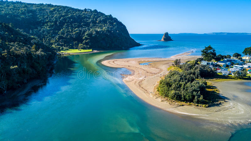 Aerial view on a river mouth with residential suburb on the shore and ocean with small islands on the background. New Zealand stock image