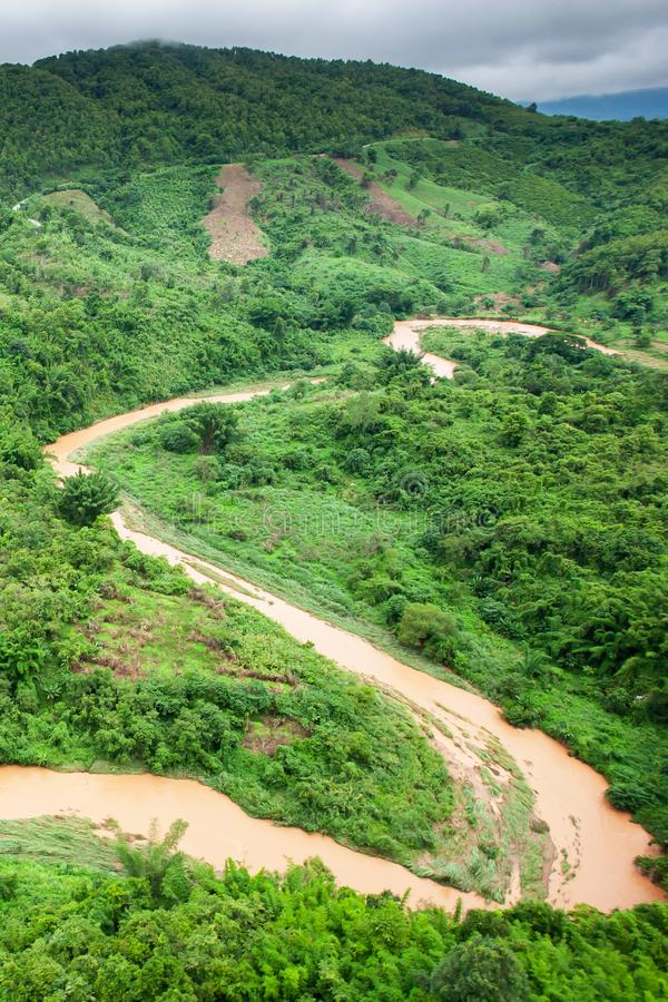 Aerial view of a river overflowing in rainy season royalty free stock image
