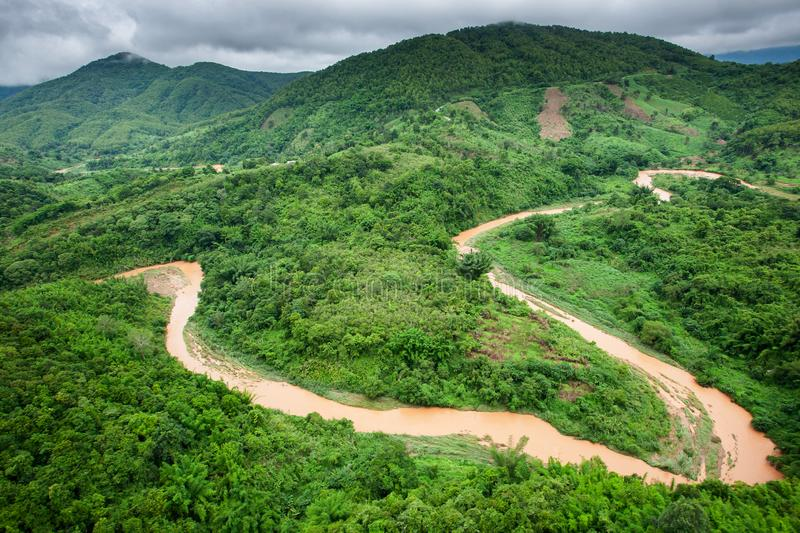 Aerial view of a river overflowing in rainy season royalty free stock images