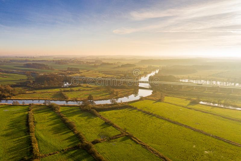 Aerial view of river warnow near Rostock - a20 highway, meadows and fields stock photography