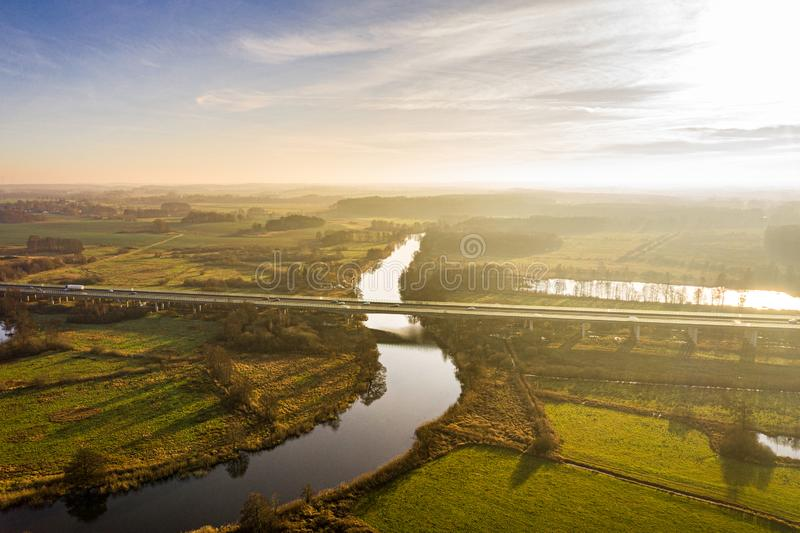 Aerial view of river warnow near Rostock - a20 highway, meadows and fields royalty free stock images