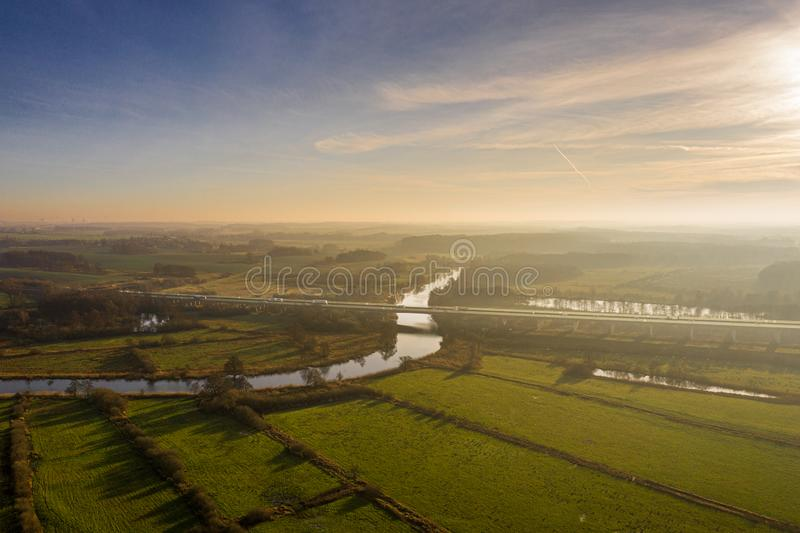 Aerial view of river warnow near Rostock - a20 highway, meadows and fields royalty free stock image