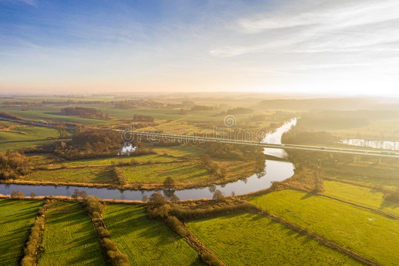 Aerial view of river warnow near Rostock - a20 highway, meadows and fields stock images