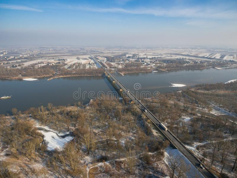 Aerial winter view of the road bridge over Vistula river. Aerial view of the road bridge over Vistula river near Gora Kalwaria city, Poland stock photo