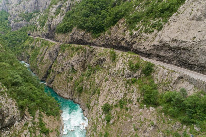 Aerial view of the road in the canyon of the river Moraca. Montenegro royalty free stock image
