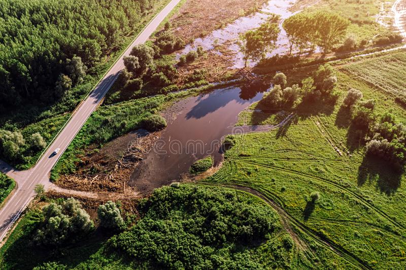 Aerial view of road through flooded countryside. From drone pov royalty free stock photos
