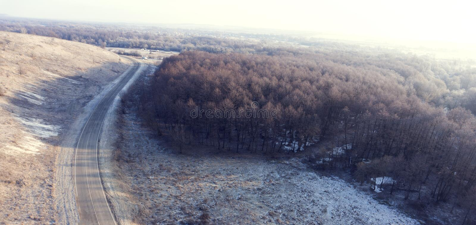 Download Aerial View On Road And Forest Landscape In Winter Season. Stock Photo - Image of meadow, over: 107764394