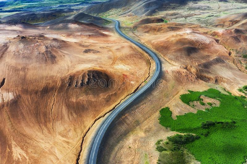 Aerial view on road in Iceland. Aerial landscape above highway in the geysers valley. Icelandic landscape from air. Famous place. stock images
