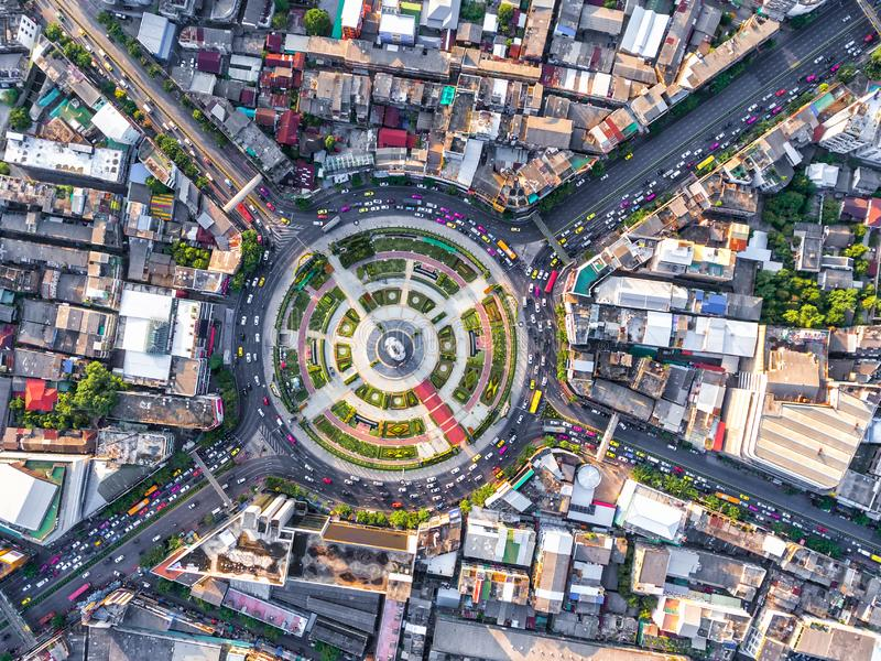 Aerial view Road roundabout with car lots Wongwian Yai in Bangkok,Thailand.street large beautiful downtown at night.cityscape. stock images