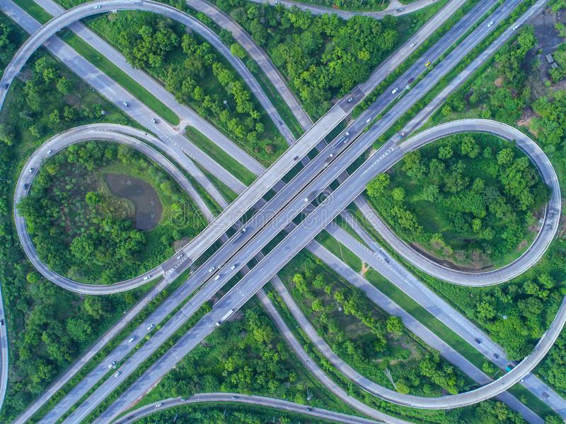 Aerial view, Road roundabout, Expressway with car lots in the ci. Ty in Thailand. beautiful Street , downtown, cityscape, Top view. Background