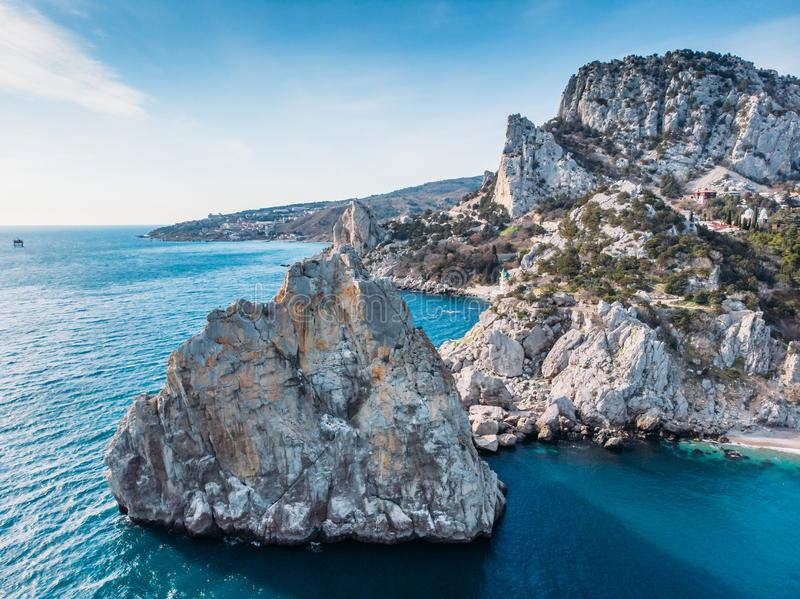 Aerial view of rock cliff Diva in Simeiz sea resort beach in Crimea, drone shot. Beautiful summer vacation nature landscape. In mountain area, toned royalty free stock photo