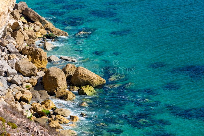 Aerial view of rocks on the sea. Overview of the seabed seen from above, transparent water royalty free stock photo