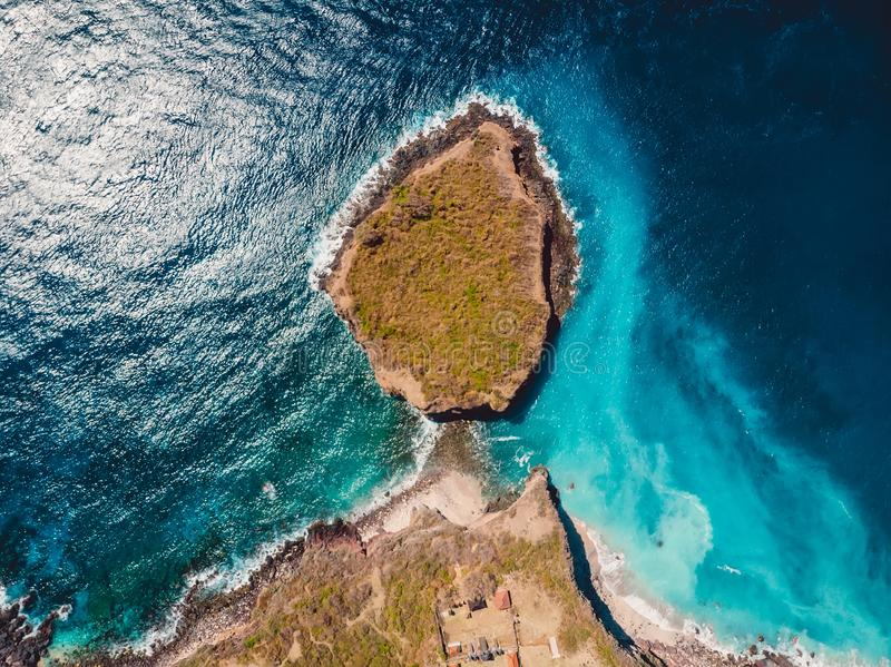 Aerial view of rocky island with rocks and blue ocean. Aerial view of rocky island with rocks and blue sea stock image