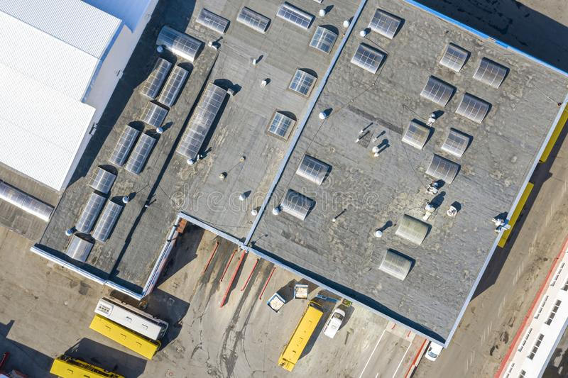 Aerial view of roofing of building at bus depot. Aerial top view of roofing of industrial building at bus depot stock images