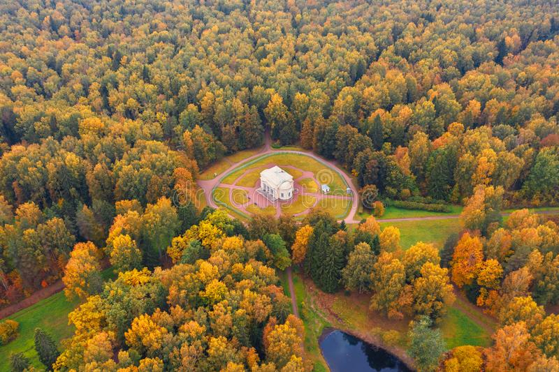 Aerial view of Round Hall building in Pavlovsky Park among the autumn trees, neighborhood of Saint-Petersburg.  royalty free stock images