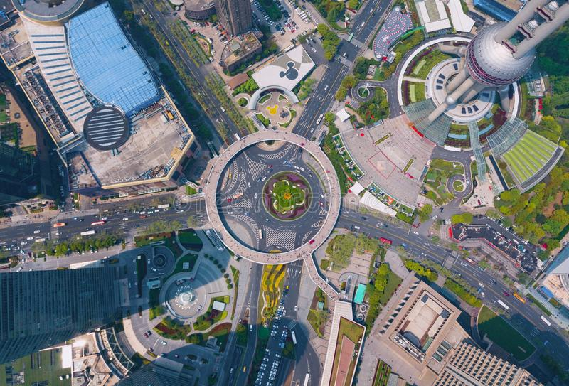 Aerial view of a roundabout with skyscraper and high-rise office buildings in Shanghai Downtown, China. Financial district and. Business centers in smart city royalty free stock photo