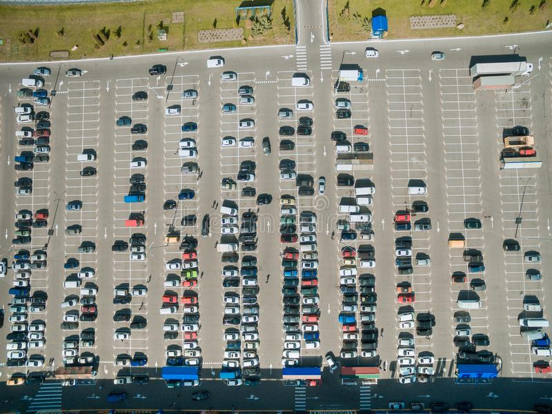 aerial view of rows of cars on parking of mall royalty free stock photos
