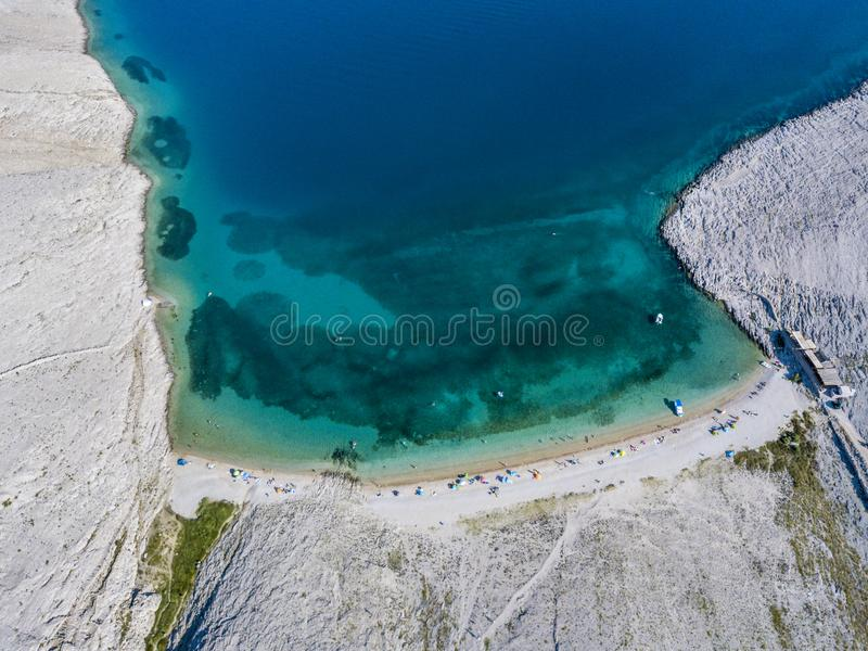 Aerial view of Rucica beach on Pag island, Metajna, Croatia. Seabed and beach seen from above, bathers, relaxation and holidays. Aerial view of Rucica beach on royalty free stock photos