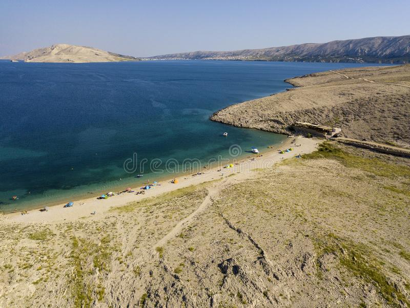 Aerial view of Rucica beach on Pag island, Metajna, Croatia. Seabed and beach seen from above, bathers, relaxation and holidays. Aerial view of Rucica beach on stock photos