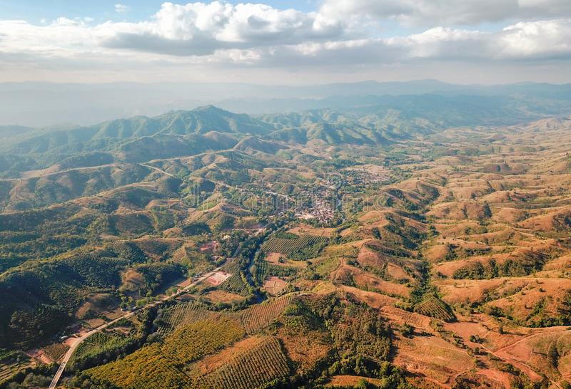 Aerial view of mountains and cloudy skies. Aerial view of rural villages in northeastern Thailand, with mountains and cloudy skies stock photos