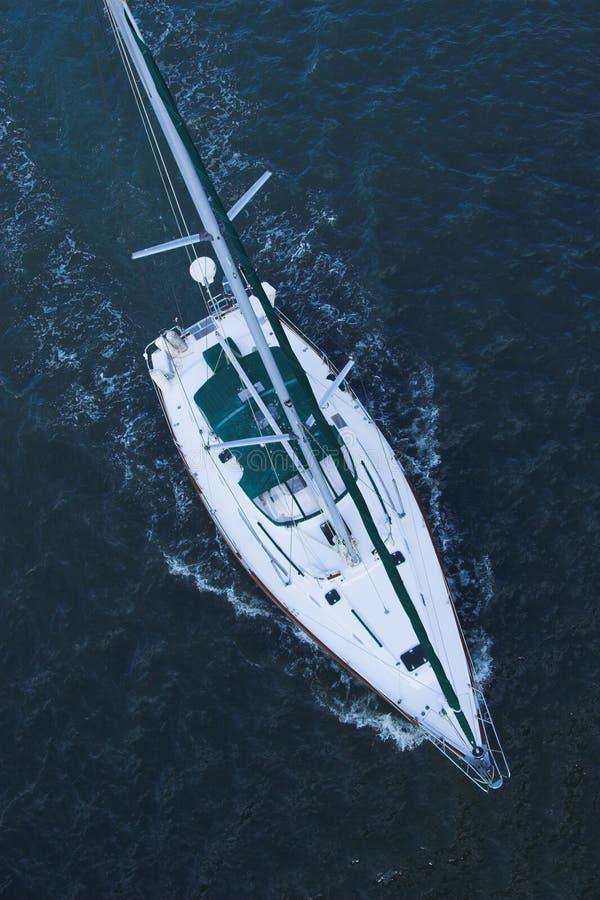 Aerial view of sailboat at sea royalty free stock photo