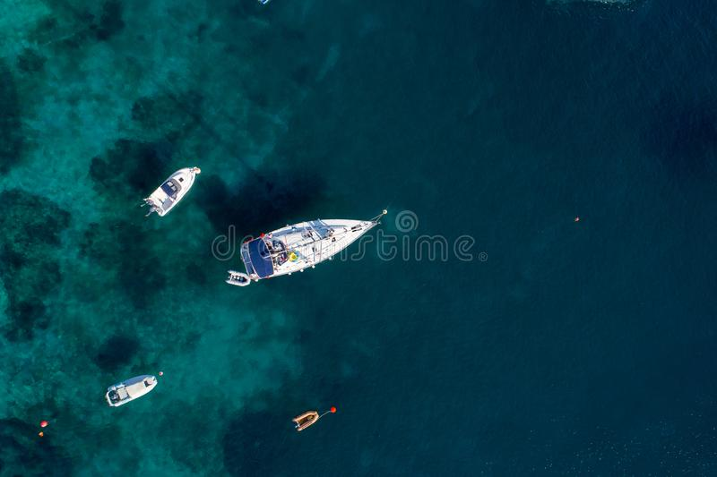 Aerial view of sailing boat on Aegean sea on Greece royalty free stock photo