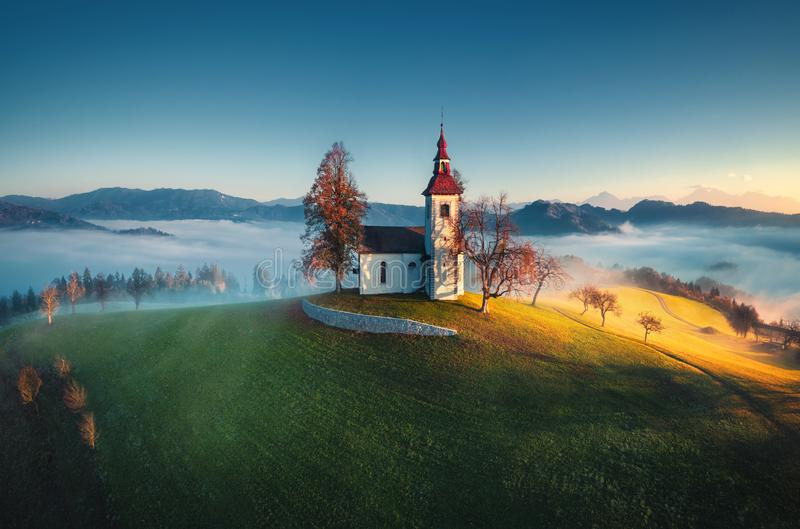 Aerial view of Saint Tomas church, Slovenia stock photo