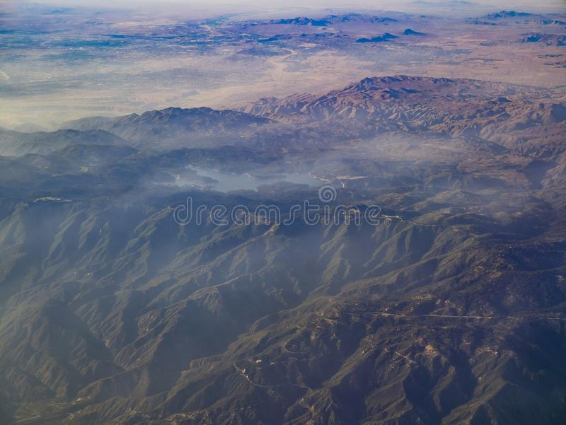 Aerial view of San Bernardino Mountains and Lake Arrowhead, view. From window seat in an airplane, California, U.S.A royalty free stock images
