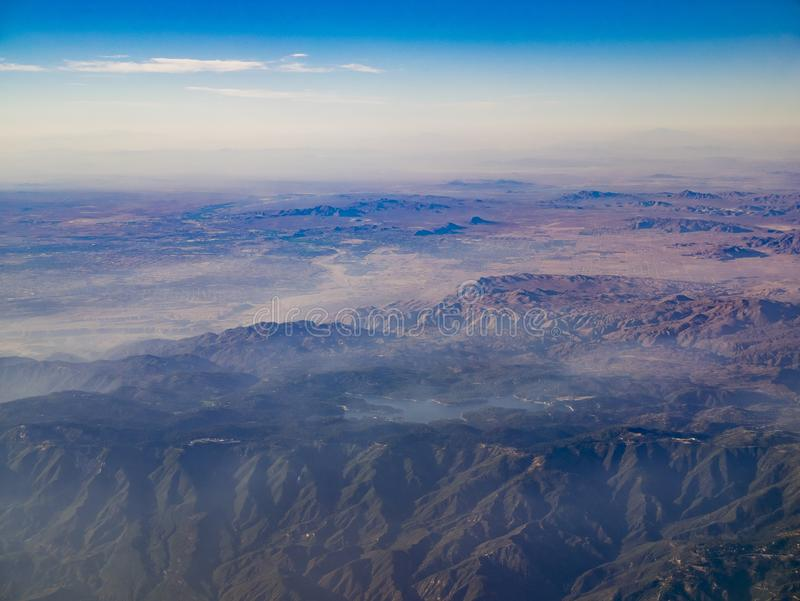 Aerial view of San Bernardino Mountains and Lake Arrowhead, view. From window seat in an airplane, California, U.S.A royalty free stock photography