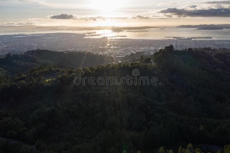 Aerial View of San Francisco Bay Area Near Sunset. A serene sunset illuminates the densely populated San Francisco Bay area including Oakland, Berkeley royalty free stock image