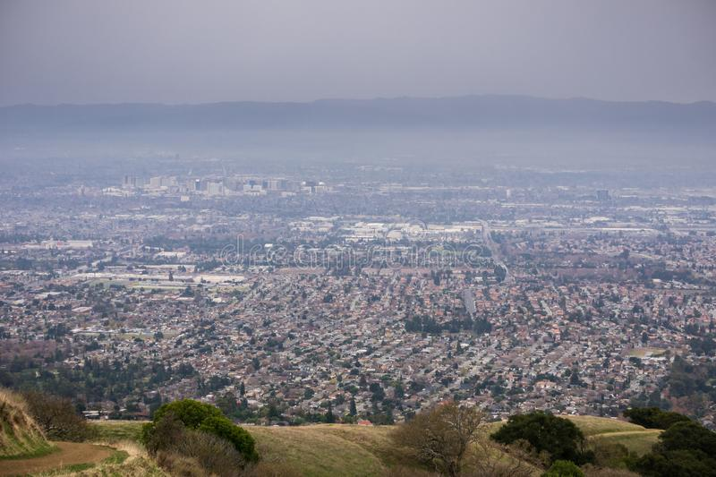 Aerial view of San Jose, California. Aerial view of residential areas of San Jose, California on a rainy day; the city`s financial district in the background stock photo