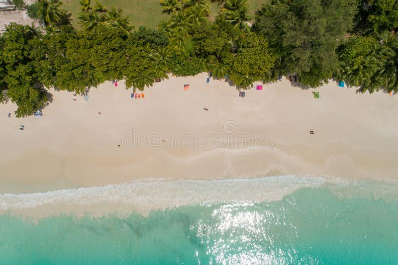 Aerial view of sandy beach with tourists swimming in beautiful clear sea water stock photography