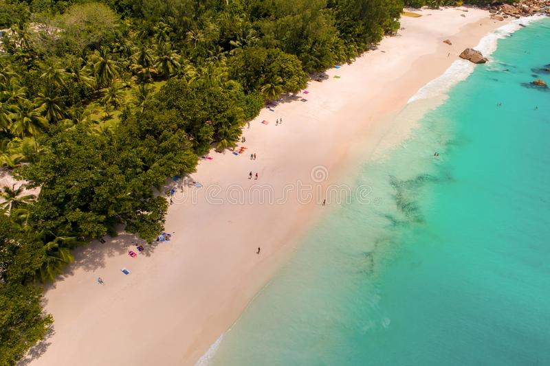 Aerial view of sandy beach with tourists swimming in beautiful clear sea water stock images