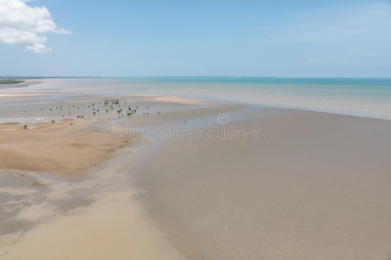 Aerial view of the sea and mudflat coastline at low tide with mangroves. Aerial view of the mudflat coastline at low tide with mangroves, Darwin, Northern stock images