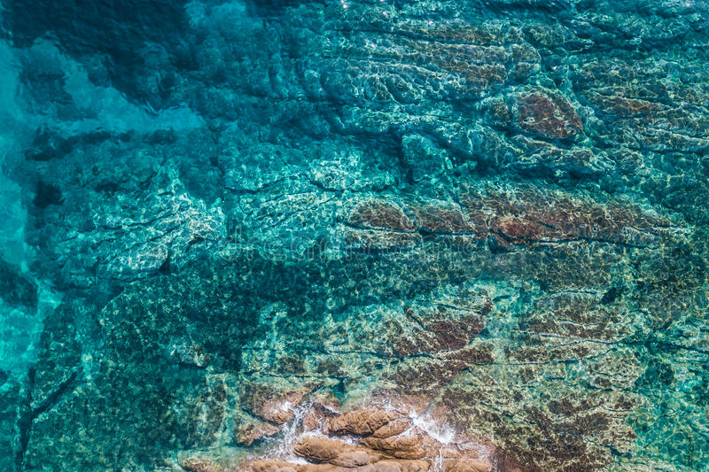 Aerial view of the sea and the rock royalty free stock photo