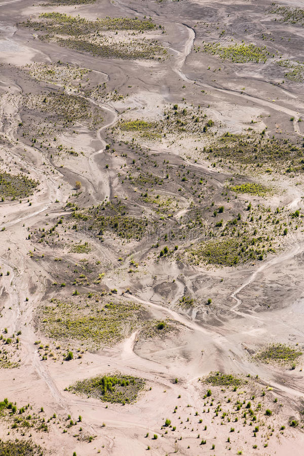 Aerial view of sea of sand inside Bromo Tengger Caldera. Mount Bromo sits in the middle of a vast plain called the Sea of Sand, a protected nature reserve royalty free stock image