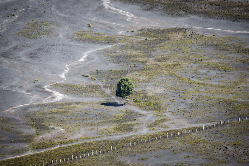 Aerial view of sea of sand inside Bromo Tengger Caldera. Mount Bromo sits in the middle of a vast plain called the Sea of Sand, a protected nature reserve royalty free stock photos