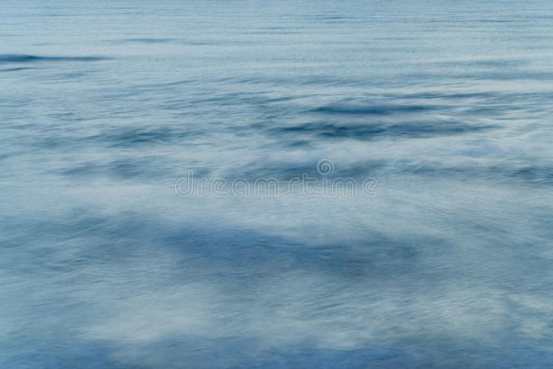 View of the sea wave with a long exposure at night stock image