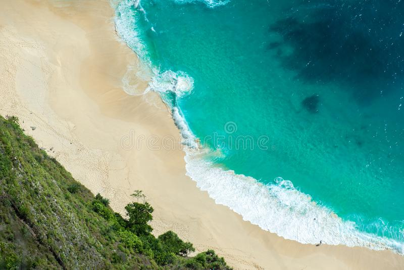 Aerial view of seascape blue ocean wave on sandy beach background.  royalty free stock photography