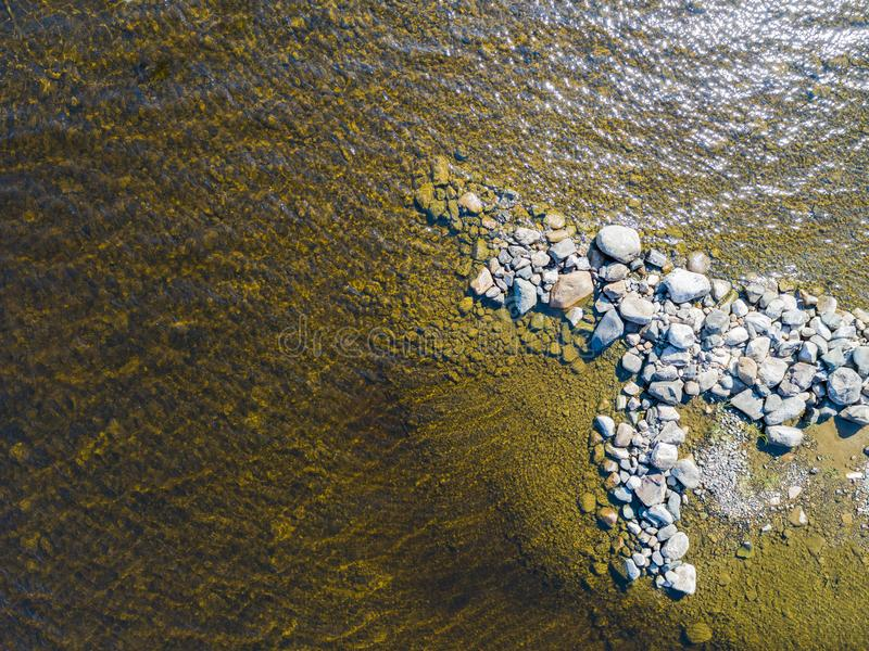 Aerial view of seashore with stone beach, lagoons and coral reefs. Coastline with sand, stone and water. Tropical landscape. Aeria. L photography. Birdseye. Sea royalty free stock image