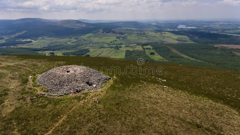 Seefin passage tomb. county Wicklow. Ireland. Aerial view. Seefin passage tomb, Blessington lake at far right. county Wicklow. Ireland royalty free stock photo